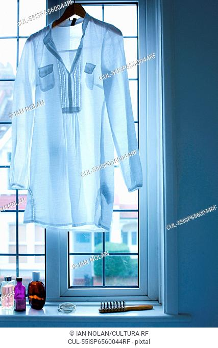 Blouse hanging in window