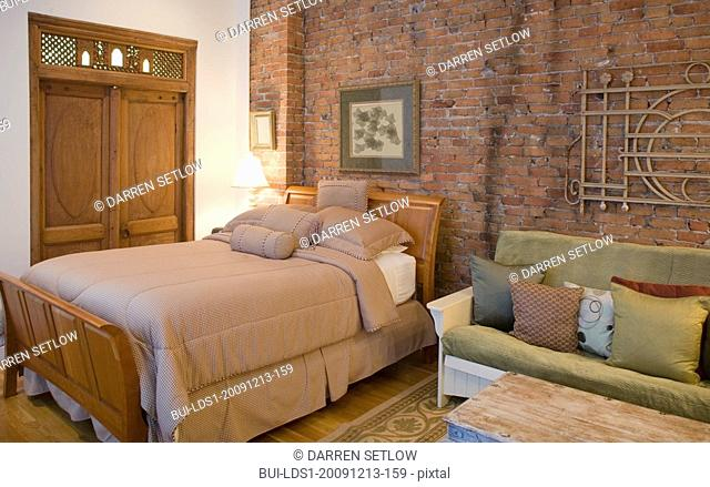 Bed and sofa in studio apartment