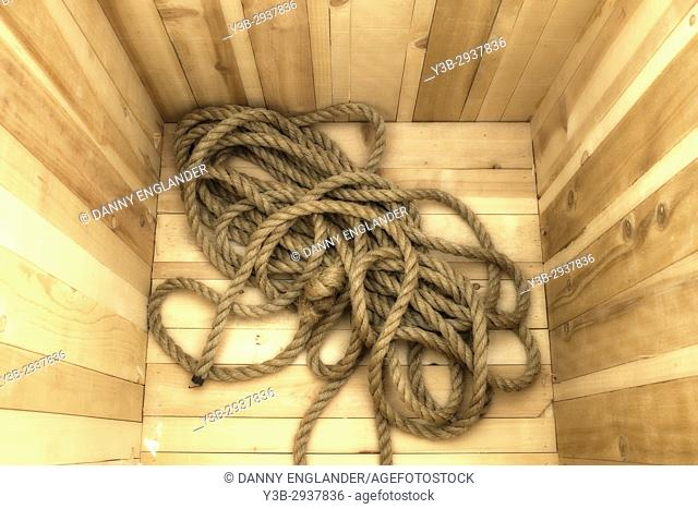 Detail of a rope in a wooden box on a sailboat