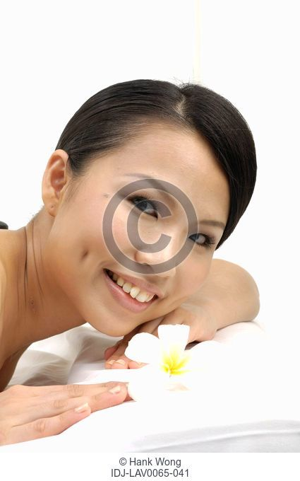 Close-up of a woman smiling in spa