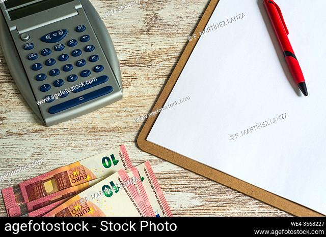 Folder with a calculator and ten-euro notes