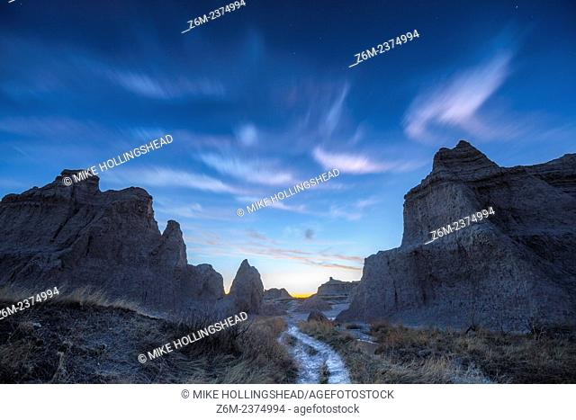 Clouds stream between rock formations in the Badlands of South Dakota