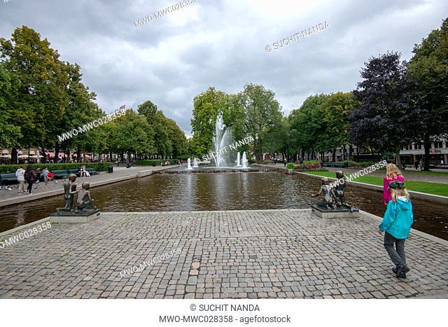 Park and water fountatin near Statue of Henrik Wergeland, Stortingsgata, Oslo, Norway