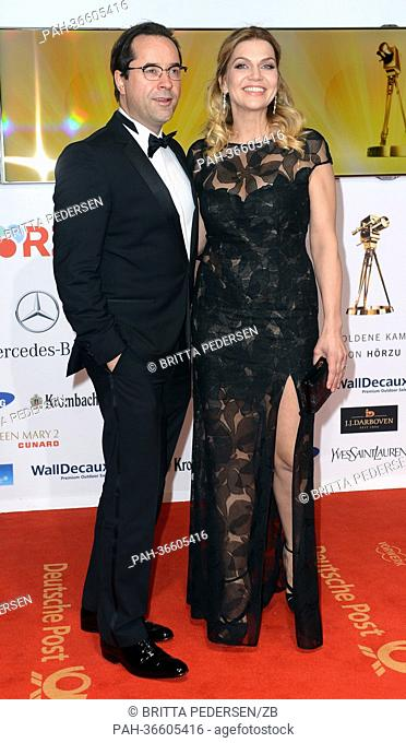 German actor Jan-Josef Liefers and his wife Anna Loos arrive for the 48th Golden Camera award ceremony in Berlin, Germany, 2 February 2013