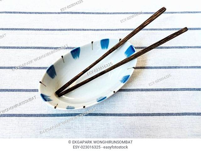 Chinese Noodle Soup Bowl with Wooden Chopsticks on Striped Fabric