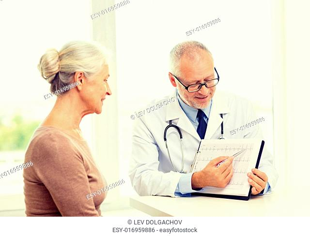 medicine, age, health care and people concept - smiling senior woman and doctor meeting in medical office