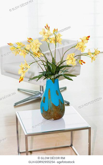 Flower vase with an armchair in a living room