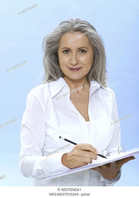Senior woman holding folder