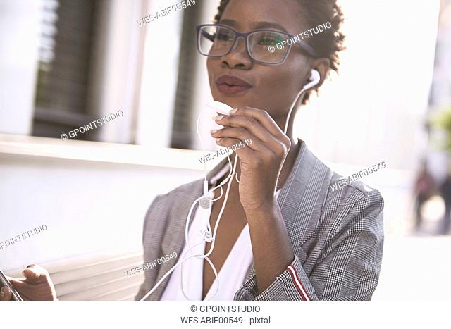 Portrait of businesswoman on the phone outdoors