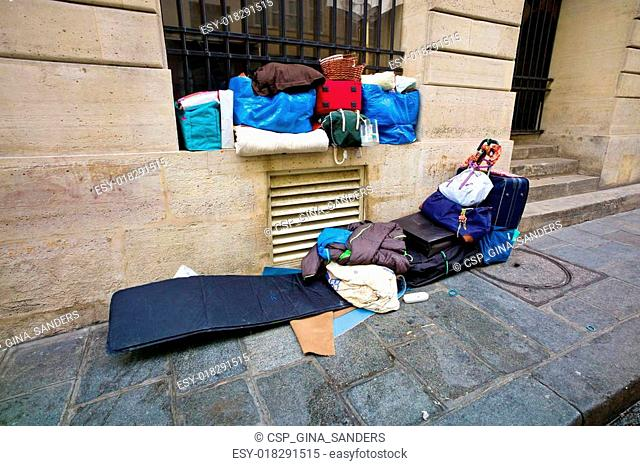 paris, france. a homeless person sleeping
