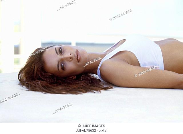 View of woman laying down posing for the camera