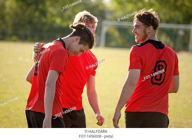 Happy sports team on field