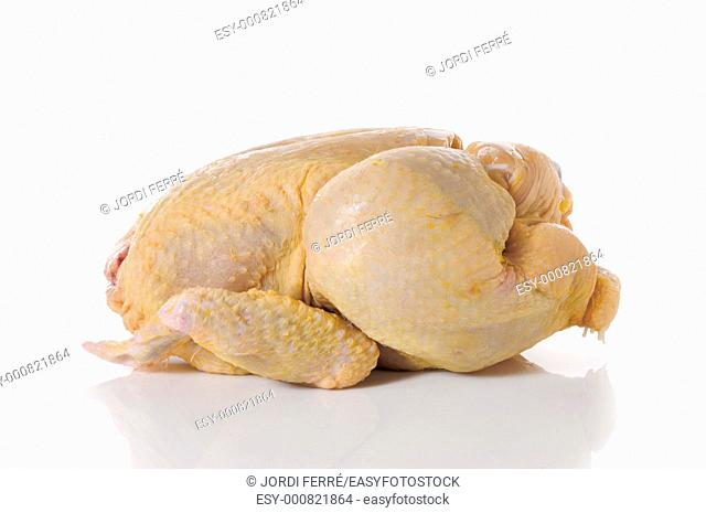 whole chicken in a red dish on white background