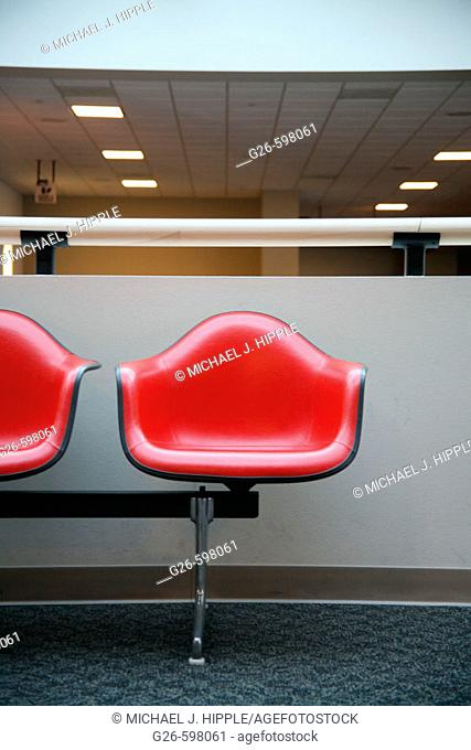 Red chairs in airport waiting area