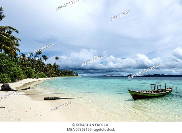 Palm beach on a banyak island with sandy beach and turquoise waters