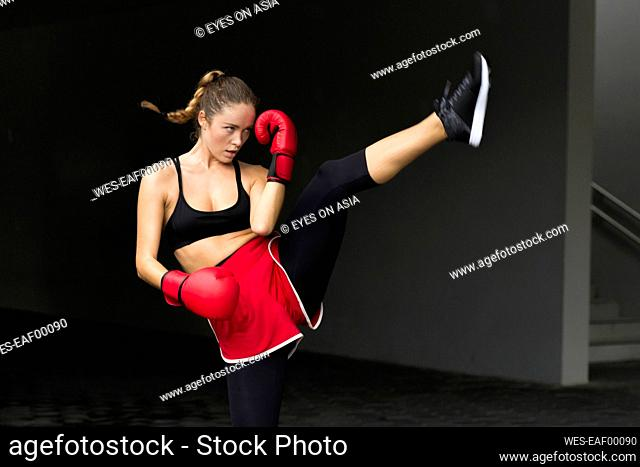 Sportswoman practicing in front of wall