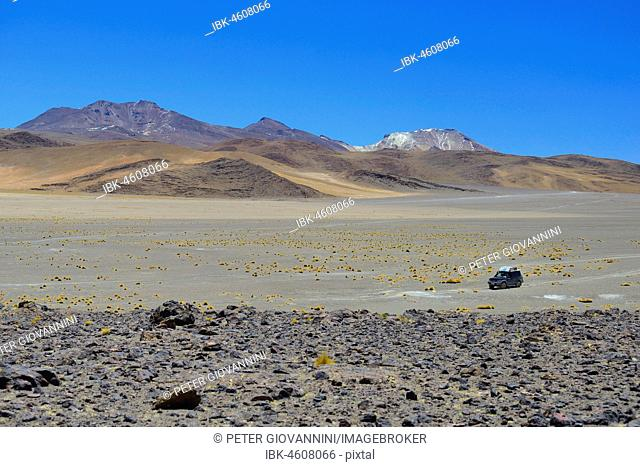 All-terrain vehicle on the lagoon route in the Andean highlands, Reserva Nacional de Fauna Andina Eduardo Abaroa, Altiplano, Sur Lípez, Bolivia