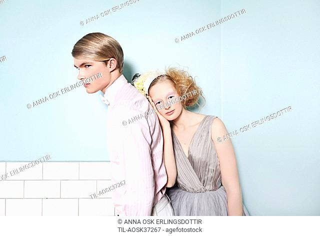 Young man and young woman dressed for special occasion with smart appearance