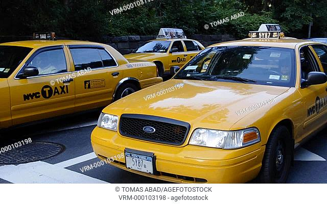Taxis traversing Central Park West, New York City