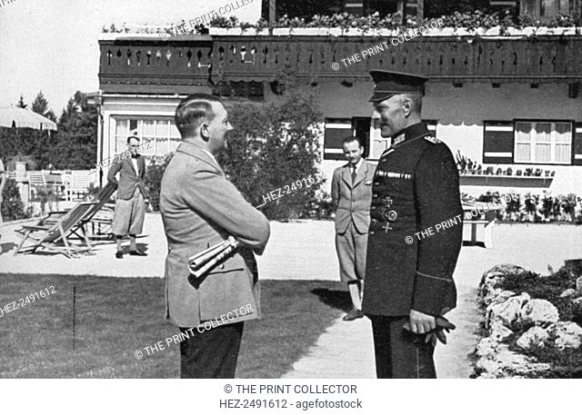 An old army comrade visits Adolf Hitler at Obersalzberg, Bavaria, Germany, 1936. Hitler (1889-1945) at his mountain retreat, the Berghof
