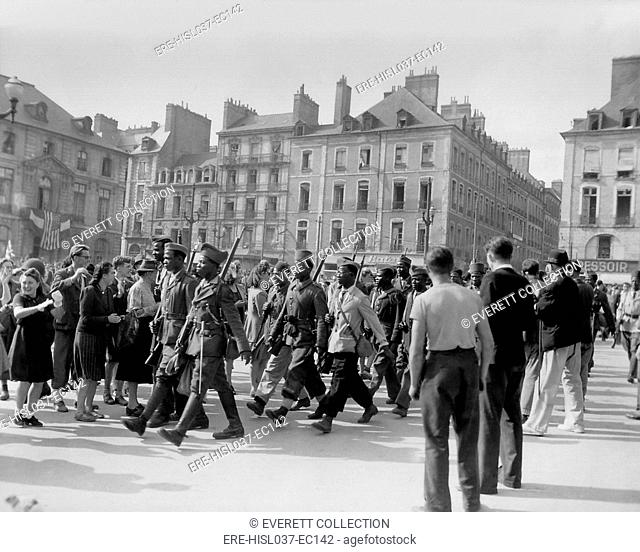 Sub-Saharian African soldiers cheered by on Liberation Day in Rennes, France, August 4, 1944. After the Liberation of Paris