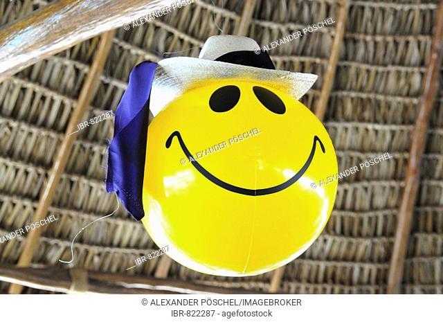 Smiley face balloon, Yulu San Juan, Rio Dulce, Guatemala, Central America