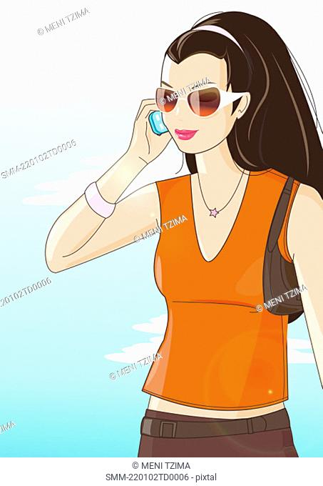 Casual woman with sunglasses talking on mobile phone