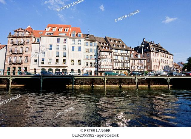 Tour Boat By Alsatian Houses On The Quai Des Bateliers By The Ill River, Strasbourg, France