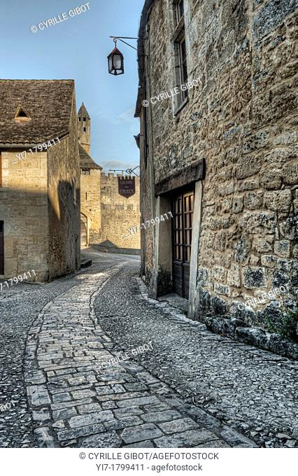 Cobblestone street in the medieval village of Beynac, Dordogne, France