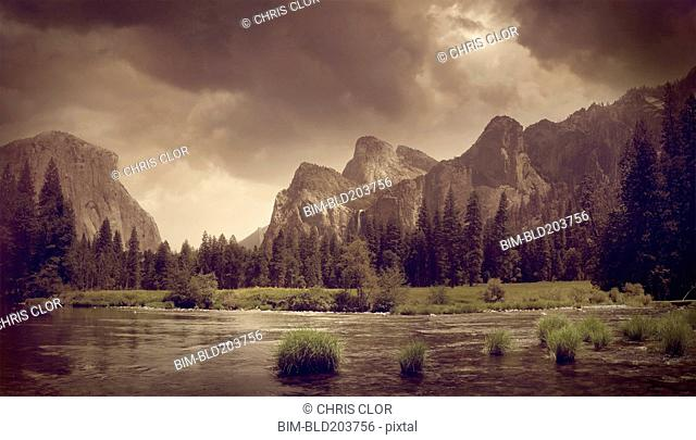 Cliffs overlooking rural landscape, Yosemite, California, United States