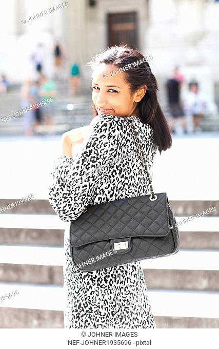 Young smiling woman on street, New York city, USA