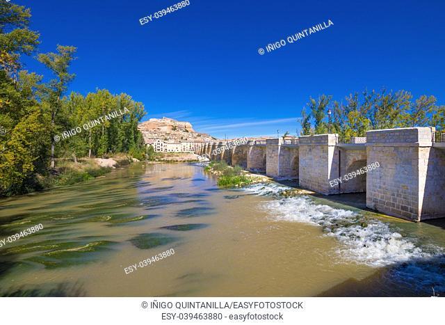 Water river Duero, medieval bridge and scenery of San Esteban de Gormaz town, landmark and monumental village in Soria, Spain, Europe