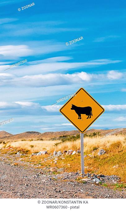 cattle crossing warning road sign