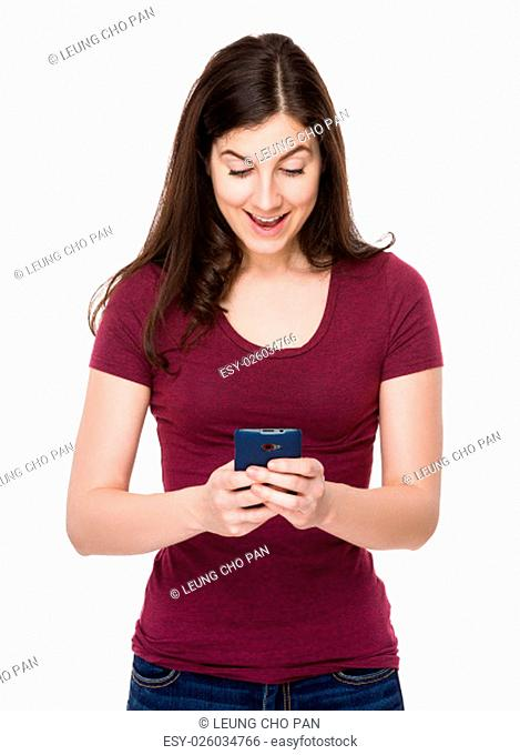 Caucasian woman play the game on mobile phone