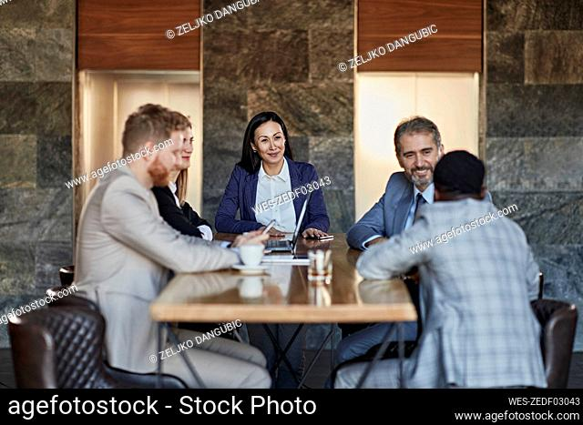 Business people having a meeting in hotel lobby