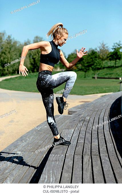 Young woman exercising on steps