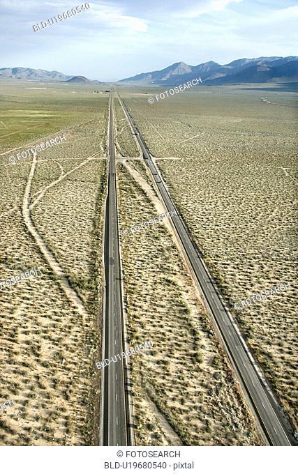Aerial of desolate scenic highway through rural desert landscape of California, USA