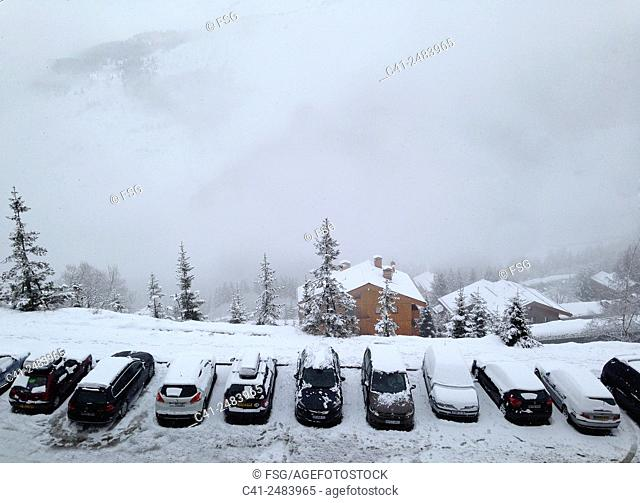 Cars parked in the snow. Mottaret. France