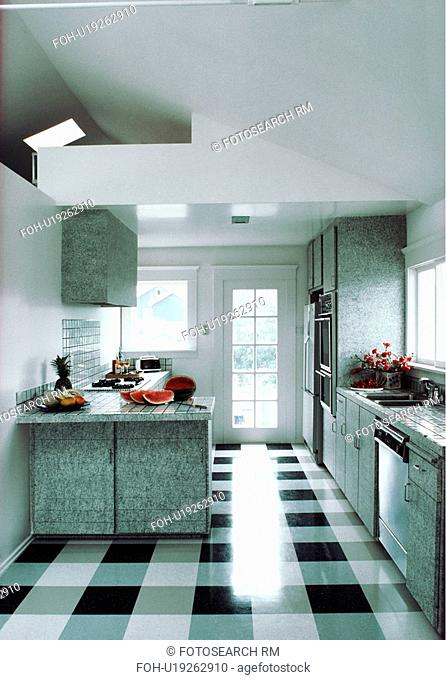 Shiny black+white checked flooring in modern white kitchen with grey granite-look fitted cupboards