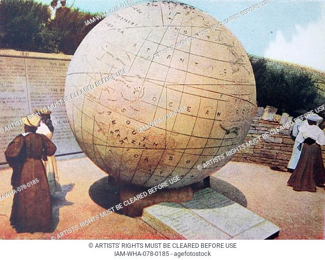 The globe erected in 1887 at Swanage, in England. Edwardian hand coloured photograph circa 1905. The Great Globe at Swanage is one of the largest stone spheres...