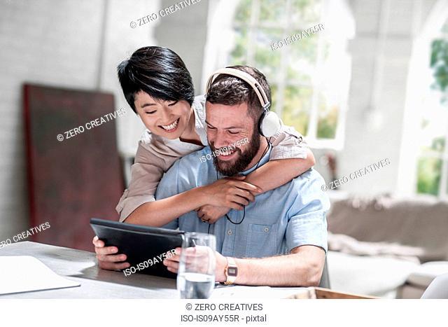 Loving couple using digital tablet