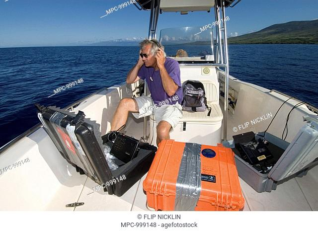 Marine biologist Dr  Jim Darling listening to and recording Humpback Whale Megaptera novaeangliae songs, Humpback Whale National Marine Sanctuary, Maui
