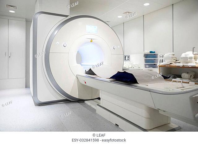 White MRI machine in empty hospital room