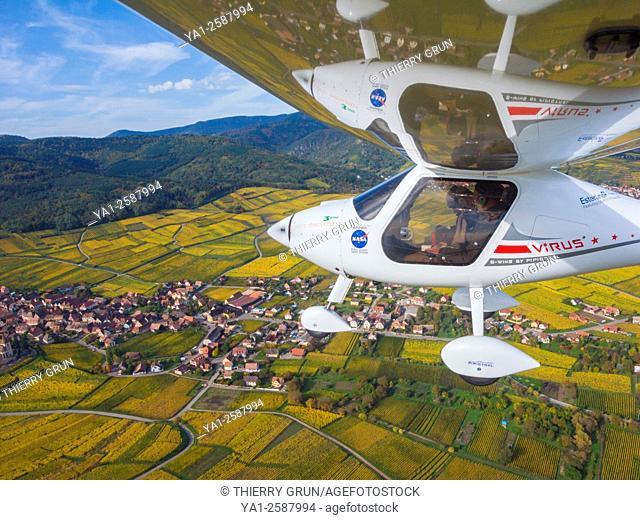 France, Haut Rhin (68), Wines road, Hunawihr, Ultralight plane Pipistrel Virus SW flying over vineyards during autumn (aerial view)