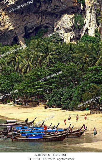 Stock Photo of Thai Tourist Boats at the beach of Ton Sai Beach in tha Andaman Sea near Krabi
