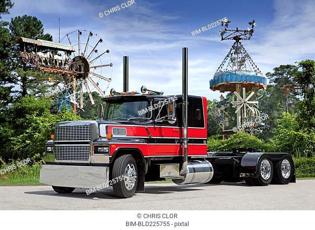 Semi-truck near amusement park