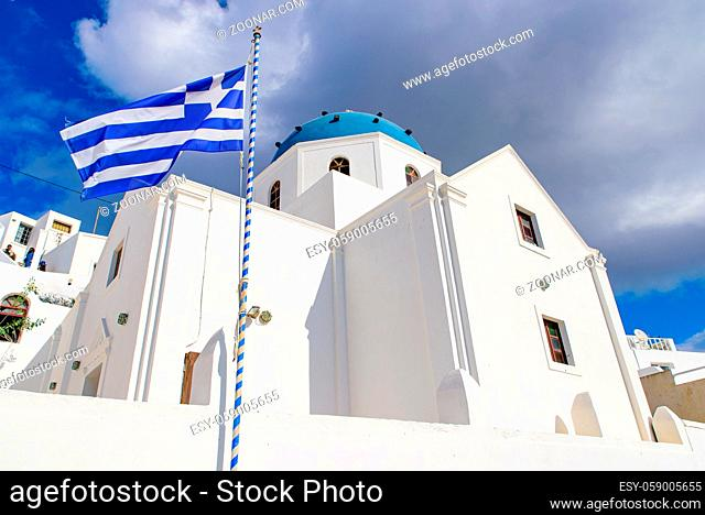 A blue domed church with bell tower in Imerovigli village, Santorini, Greece