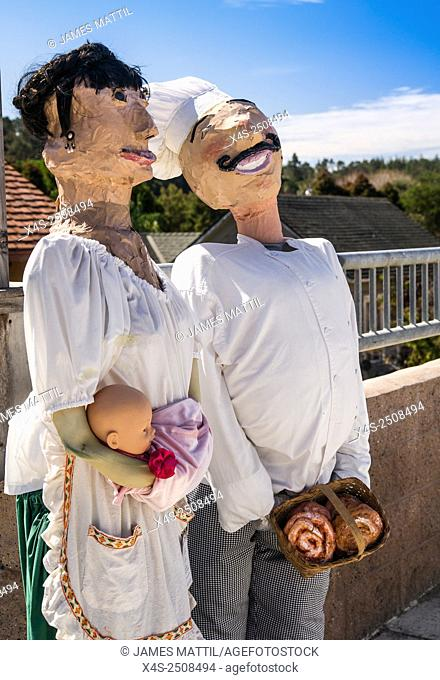 A homemade scarecrow depicting story book characters at a Halloween festival