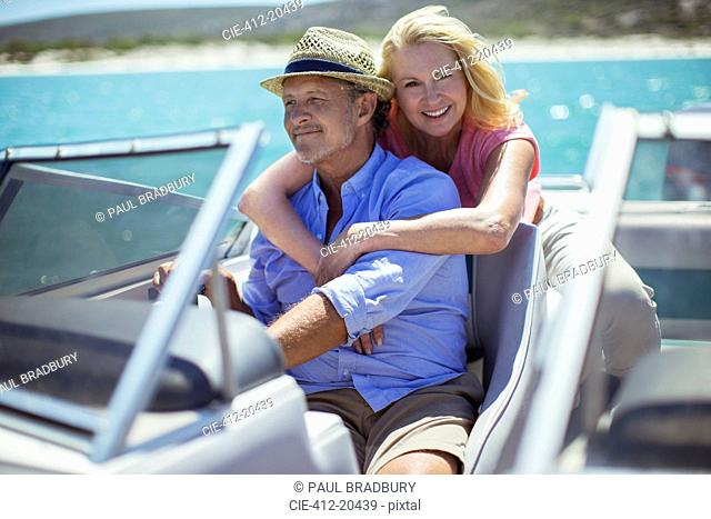 Older couple relaxing on boat