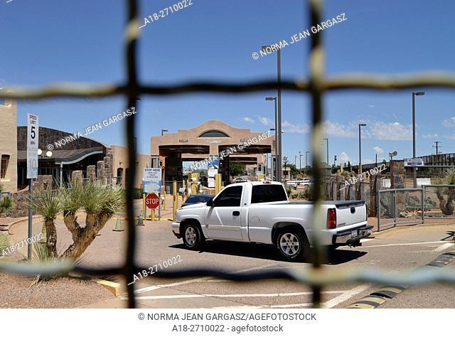 Vehicles enter the inspection station at the port-of-entry in Naco, Arizona, USA, from Naco, Sonora, Mexico, as seen from Arizona
